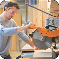 Man Using Circular Table Saw